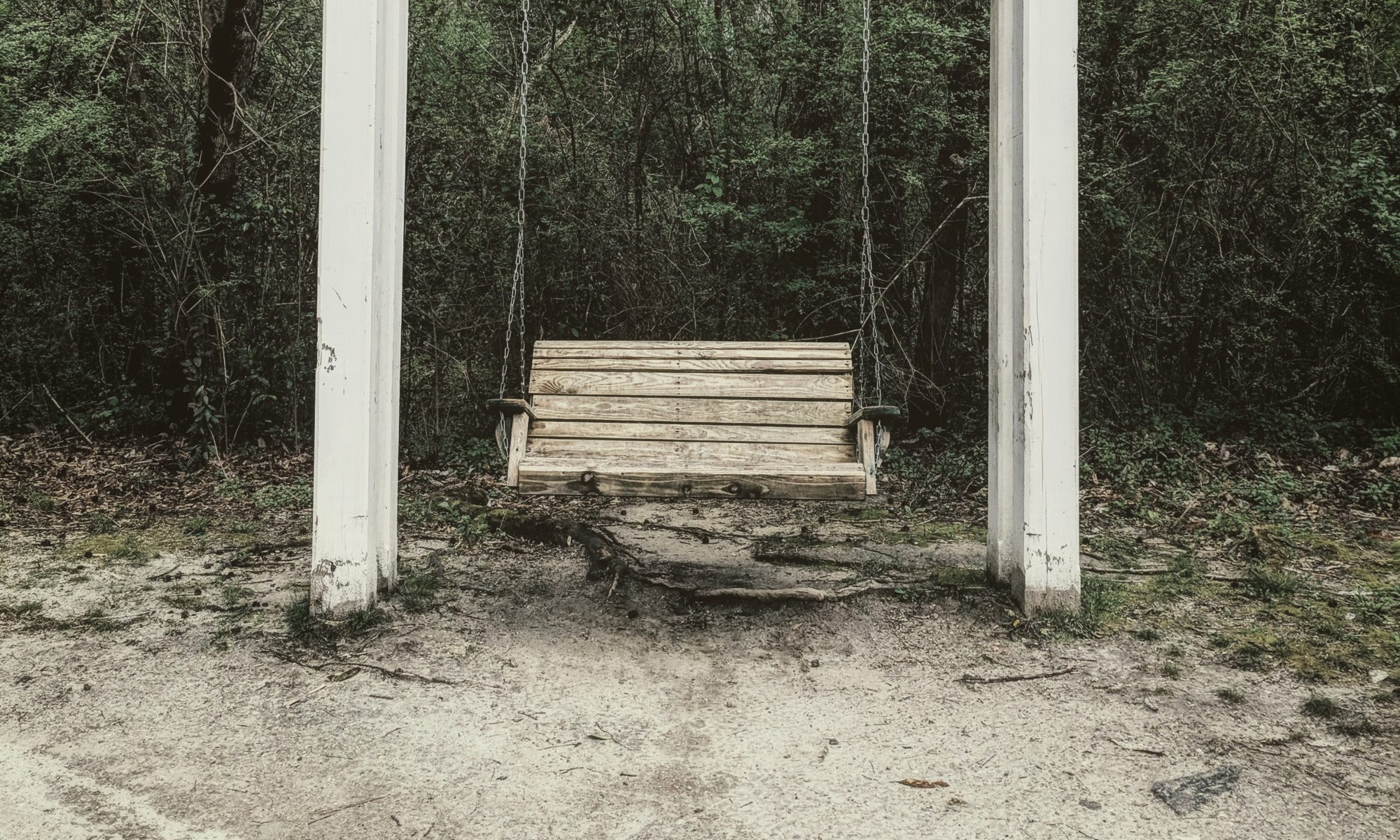 Empty porch swing.